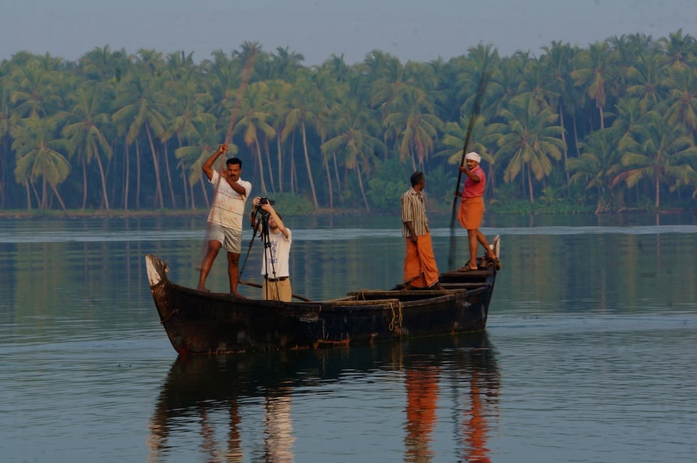 Zac Osgood, videographer, filming fishermen off The Lotus on the backwaters of Kerala.