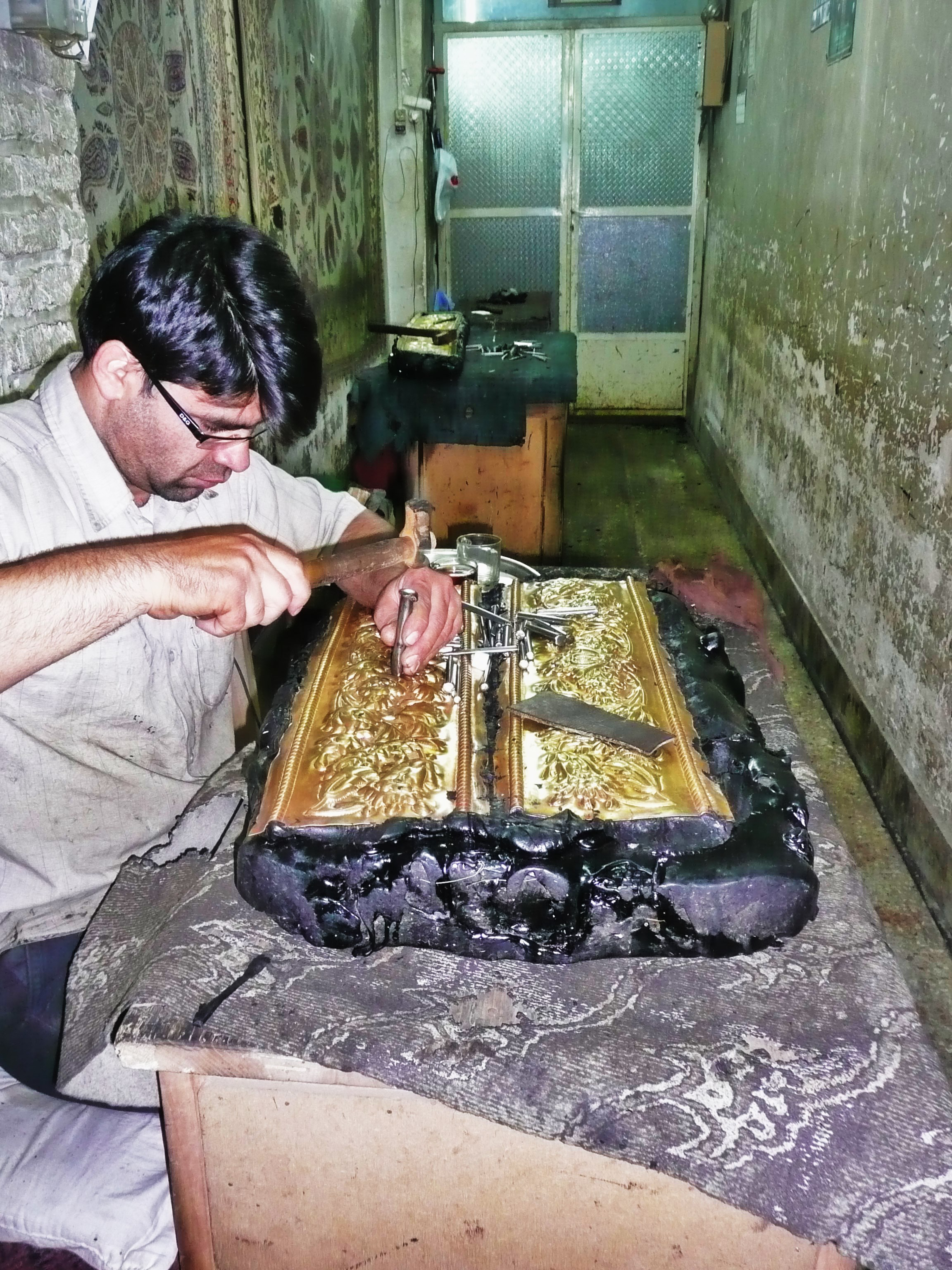 A man working with silver in Isfahan.