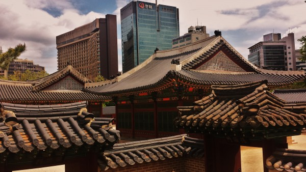 Deoksugung Palace juxtaposed with the new city of Seoul.
