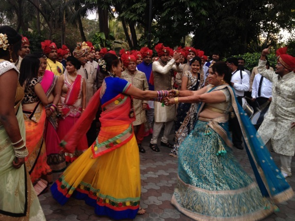 The hectic and festive dancing just getting started at a wedding at The Leela Mumbai.