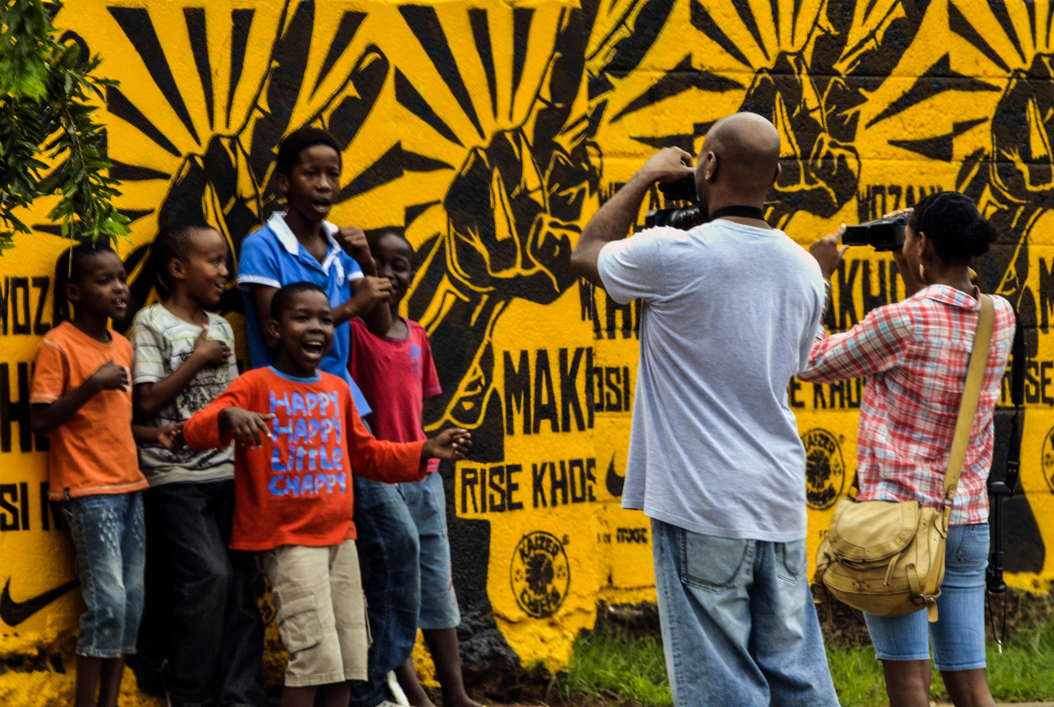 Snapping some photos of kids in SOWETO. Just be sure to show them the photos afterwards!