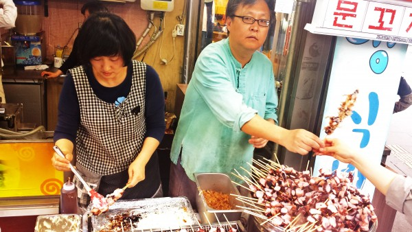 Fresh grilled octopus served on the street in Insadong, Seoul.