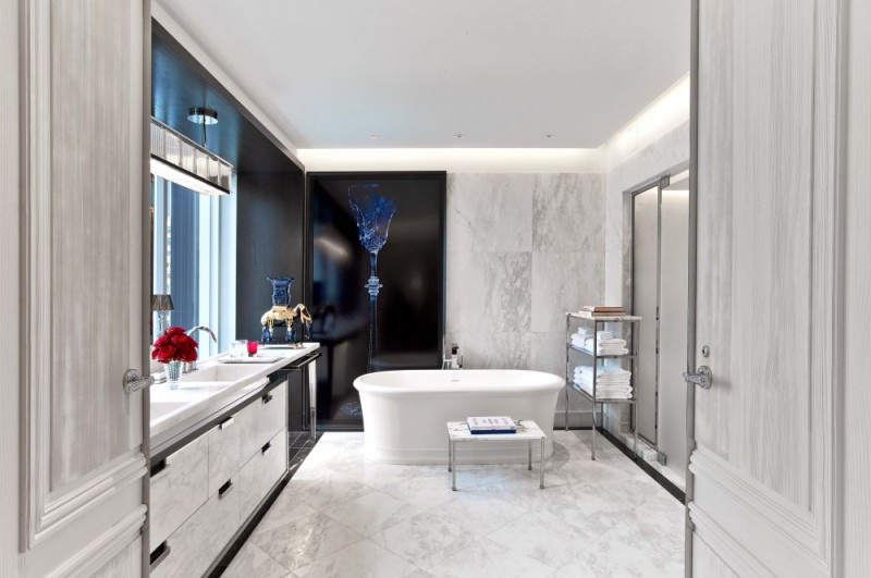 immaculately white bathrooms with soaking tubs tempting you to dip in photo credit baccarat hotel